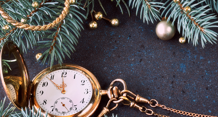 pocket watch around christmas tree year end planning